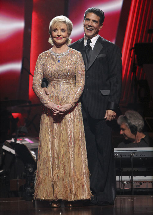 Florence Henderson and Corky Ballas wait to hear their fate on 'Dancing With the Stars: The Results Show,' Tuesday, Oct. 19, 2010. The judges gave the couple 21 points out of 30.