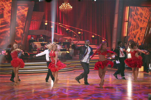 "<div class=""meta ""><span class=""caption-text "">Mwano Family Dance, with professional dancers Anna Trebunskaya, Chelsie Hightower, Kym Johnson and Karina Smirnoff, performs on 'Dancing With the Stars: The Results Show,' Tuesday, Oct. 19, 2010. (ABC Photo/Adam Larkey)</span></div>"