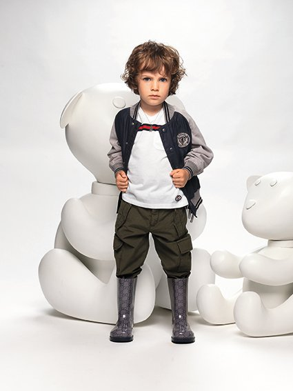 An unidentified child models Gucci apparel from...