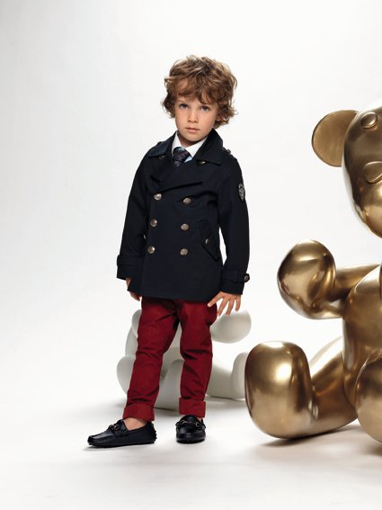 An unidentified child models Gucci apparel from the company&#39;s Spring&#47;Summer 2011 children&#39;s line. <span class=meta>(Gucci &#47; facebook.com&#47;GUCCI)</span>