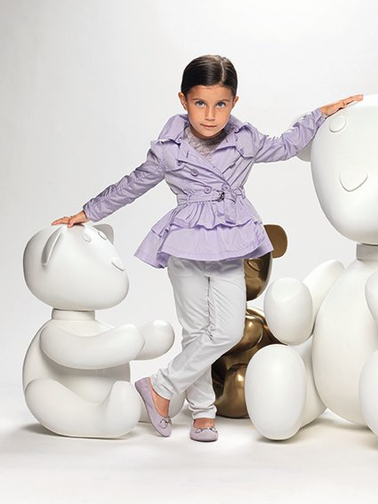 "<div class=""meta ""><span class=""caption-text "">An unidentified child models Gucci apparel from the company's Spring/Summer 2011 children's line. (Gucci / facebook.com/GUCCI)</span></div>"