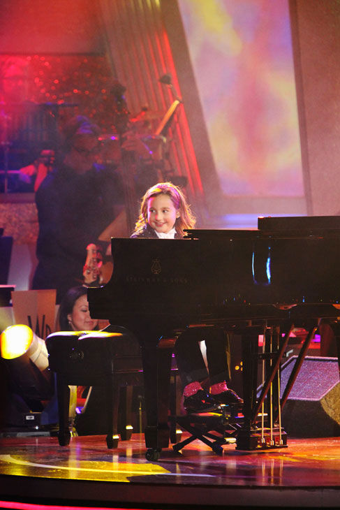 "<div class=""meta ""><span class=""caption-text "">Nine-year-old piano prodigy Emily Bear performed on 'Dancing With the Stars: The Results Show' on Tuesday Nov. 9, 2010. She was accompanied by young ballroom dance champions Sophia Latessa and Tyler Golman (age 9) and Rickie Taylor and Erik Linder (age 10). (ABC Photo/ Adam Larkey)</span></div>"