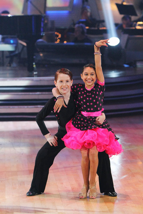 "<div class=""meta image-caption""><div class=""origin-logo origin-image ""><span></span></div><span class=""caption-text"">Nine-year-old piano prodigy Emily Bear performed on 'Dancing With the Stars: The Results Show' on Tuesday Nov. 9, 2010. She was accompanied by young ballroom dance champions Sophia Latessa and Tyler Golman (age 9) and Rickie Taylor and Erik Linder (age 10). (ABC Photo/ Adam Larkey)</span></div>"