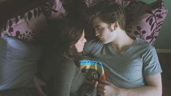 ella Swan (Kristen Stewart) and Edward Cullen (Robert Pattinson) cuddle in bed, contemplating their future.