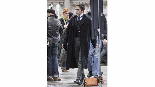 British actor Robert Pattinson, star of Twilight, walks on the set of his new film 'Bel Ami' in Budapest, Hungary, Tuesday, April 6, 2010.