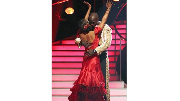 NFL star Chad Ochocinco and Cheryl Burke react to being safe on 'Dancing With the Stars: The Results Show,' Tuesday, April 6, 2010. The couple scored 20 points out of 30 on Monday's show.