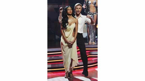 Singer Nicole Scherzinger and partner Derek Hough react to being safe 'Dancing With the Stars: The Results Show,' Tuesday, April 12, 2010. The couple scored 50 points out of 60 on Monday's show.