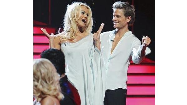 Actress Pamela Anderson and partner Damian Whitewood react to being safe on 'Dancing With the Stars: The Results Show,' Tuesday, April 13, 2010. The couple scored 47 points out of 60 on Monday's show.