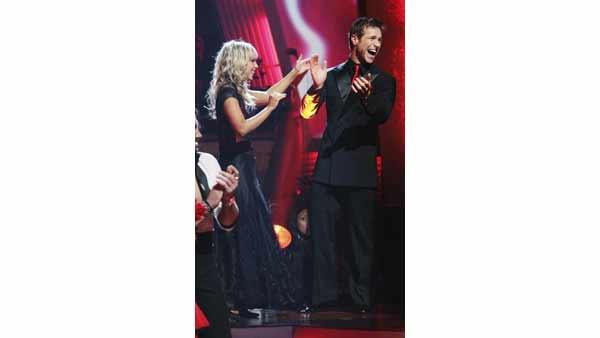 'Bachelor' Jake Pavelka and Chelsie Hightower react to being safe on 'Dancing With the Stars: The Results Show,' Tuesday, April 13, 2010. The couple scored 38 points out of 60 on Monday's show.
