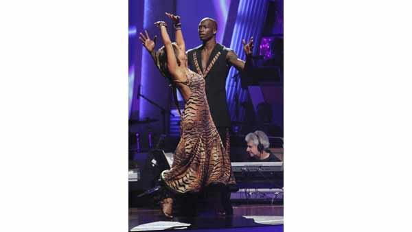 NFL star Chad Ochocinco and Cheryl Burke react to being safe on 'Dancing With the Stars: The Results Show,' Tuesday, April 20, 2010. The couple scored 18 points out of 30 on Monday's show.