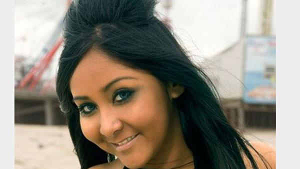 Nicole Polizzi, better known as Snooki from the MTV reality show 'Jersey Shore' that follows eight housemates spending their summer on the New Jersey Shore.  She is known for her image, of a tanned body and the hairstyle poof she wears everywhere .