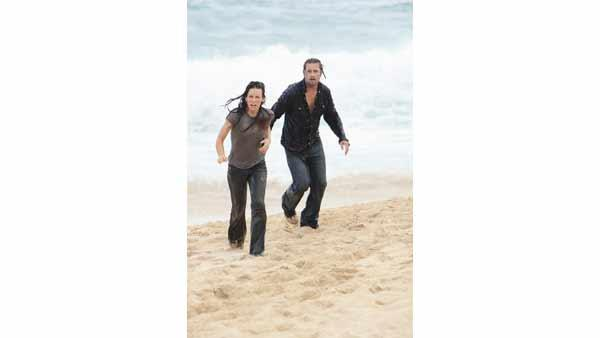 Meanwhile, back on the Island, Kate Austen (Evangeline Lilly) and Sawyer (Josh Holloway) make a run for the beach. Nice day for a swim?