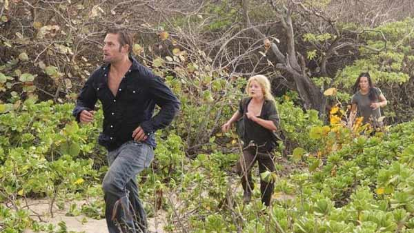 Sawyer (Josh Holloway) leads Claire Littleton (Emilie de Ravin) and Kate Austen (Evangeline Lilly) on a run through the forest.