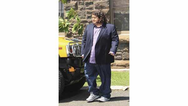 Hurley (Jorge Garcia) stands beside his baller ride.