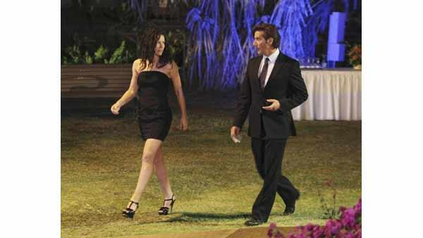 Kate Austen (Evangeline Lilly) is escorted by a spiffy Desmond Hume (Henry Ian Cusick) to her destiny.