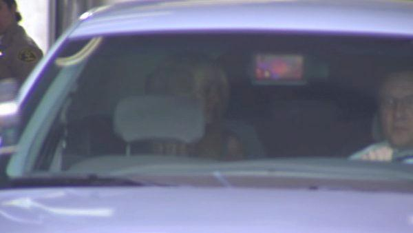 Lindsay Lohan sits in the back of the car that escorted her to the Century Regional Detention Facility in Lynwood where she is set to serve a 90-day sentence for violating the terms of her probation.