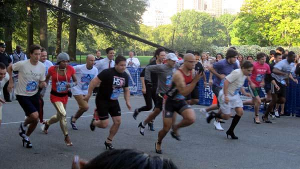 The men take off at the start of their race in the second High Heel-a-thon in Central Park.