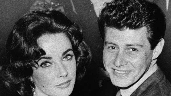 In this 1959 file photo, actress Elizabeth Taylor is seen with singer Eddie Fisher before their marriage. He died Wednesday night. He was 85.
