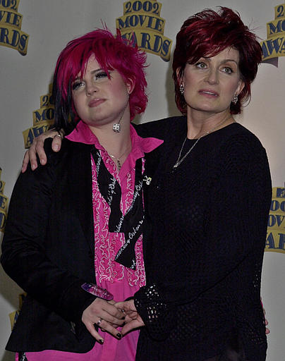 Kelly Osbourne, left, and mother, Sharon, pose for photographers after Kelly&#39;s performance at the MTV Movie Awards in Los Angeles, Saturday, June 1, 2002. <span class=meta>(AP Photo&#47;Reed Saxon)</span>