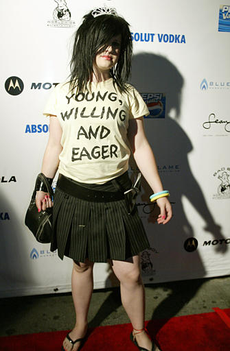 "<div class=""meta ""><span class=""caption-text "">Singer Kelly Osbourne poses at a party hosted by P. Diddy after the MTV Video Music Awards in New York, Friday, Aug. 29, 2003. (AP Photo/Diane Bondareff)</span></div>"