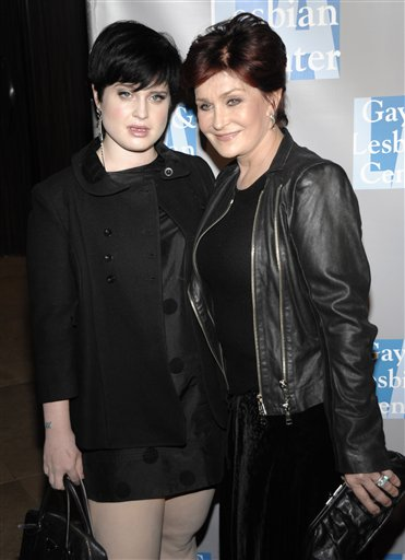 Kelly Osbourne, left, and Sharon Osbourne arrive...