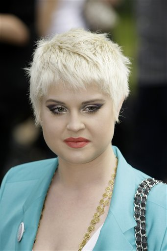 "<div class=""meta image-caption""><div class=""origin-logo origin-image ""><span></span></div><span class=""caption-text"">Kelly Osbourne poses for photographs during the launch of a new food campaign entitled 'Meat Free Monday' in London, Monday June 15, 2009. The campaign encourages people to try and help slow climate change by having one meat free day a week.  (AP Photo/Matt Dunham)</span></div>"