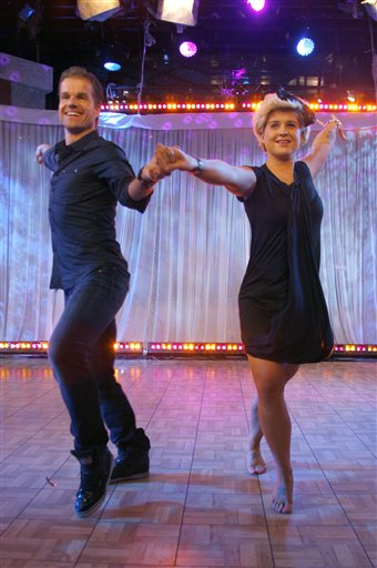 Kelly Osbourne, right, and her dancing partner Louis Van Amstel from the dance competition series &#39;Dancing with the Stars,&#39; appear on ABC&#39;s &#39;Good Morning America&#39; on Wednesday, Nov. 25, 2009 in New York. <span class=meta>(AP Photo&#47;Andy Kropa)</span>
