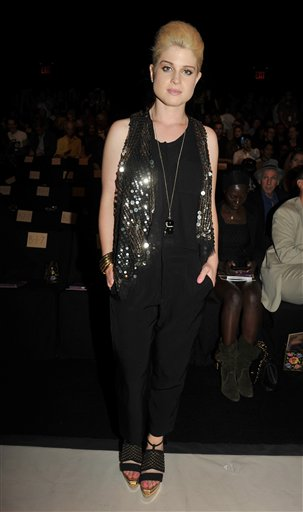 "<div class=""meta image-caption""><div class=""origin-logo origin-image ""><span></span></div><span class=""caption-text"">Kelly Osbourne is seen before the Anna Sui spring 2011 collection is shown during Fashion Week in New York, Wednesday, Sept. 15, 2010. (AP Photo/Diane Bondareff)</span></div>"