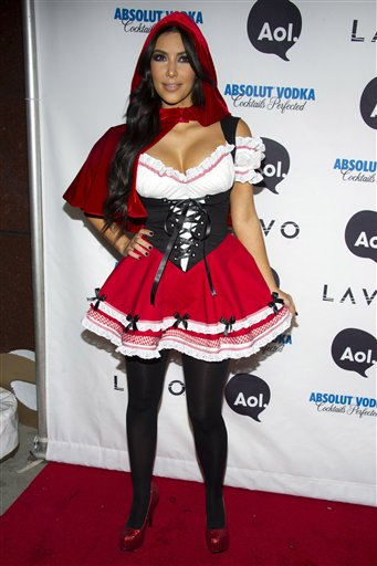 Kim Kardashian, dressed in a Little Red Riding...