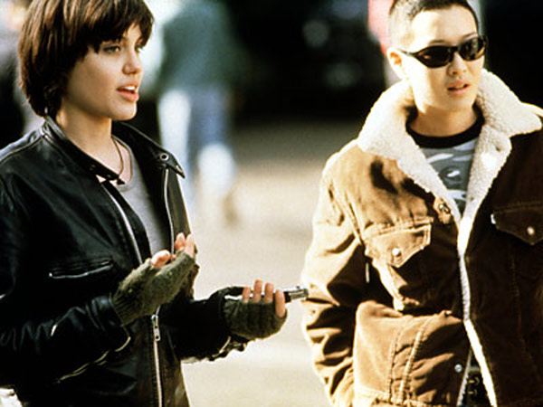 "<div class=""meta ""><span class=""caption-text "">In 1998 Angelina began a relationship with her 'Foxfire' costar, Jenny Shimizu, who once was a mechanic before she became an actress. (Photo courtesy of Sony Pictures)</span></div>"