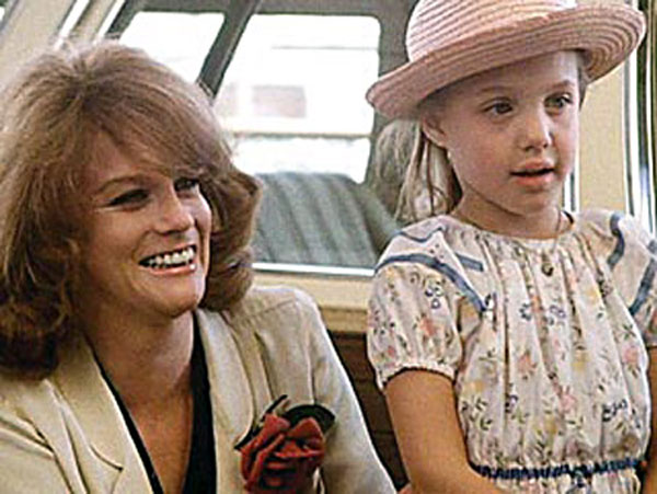 "<div class=""meta ""><span class=""caption-text "">The first film Angelina appeared in was 'Lookin' to Get Out', with her father Jon Voight when she was six years old.  (Photo courtesy of Warner Home Video)</span></div>"