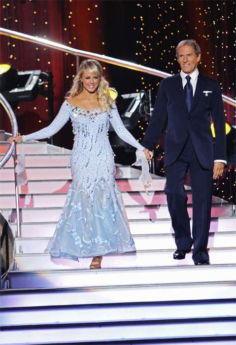 "<div class=""meta ""><span class=""caption-text "">Michael Bolton and Chelsie Hightower enter the stage on 'Dancing With the Stars,' Monday, Sept.  20, 2010. The judges gave the couple 16 points out of 30. (ABC Photo/ Adam Larkey)</span></div>"