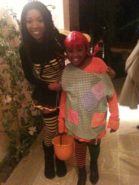 Singer and 'Dancing With the Stars' contestant Brandy dressed up like a bumble bee and took her 8-year-old daughter Sy'rai Trick-or-Treating.