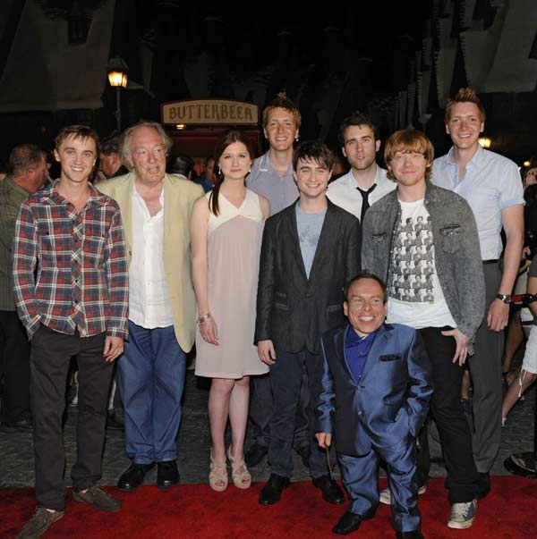 "<div class=""meta ""><span class=""caption-text "">The Wizarding World of Harry Potter at Universal Orlando Resort kicked off its grand opening celebration on June 18 with help from 'Harry Potter' film stars Tom Felton, Michael Gambon, Bonnie Wright, Oliver Phelps, Daniel Radcliffe, Matthew Lewis, Warwick Davis, Rupert Grint and James Phelps. Hundreds of people gathered in front of Hogwarts castle for a spectacular display of fireworks choreographed to a special performance of music from the Harry Potter films conducted live by renowned composer John Williams. (Photo courtesy of Universal Orlando Resort)</span></div>"