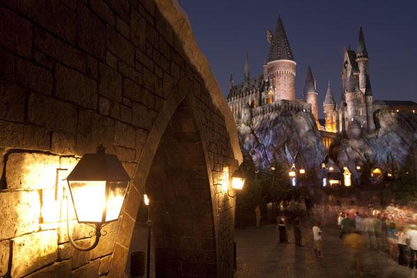 "<div class=""meta ""><span class=""caption-text "">The 20-acre area includes the village of Hogsmeade featuring Zonko's joke shop, Honeydukes, the Three Broomsticks, the Hog's Head pub, the Owlery and Owl Post, Ollivanders and Dervish and Banges. Just beyond Hogsmeade is Filch's Emporium of Confiscated Goods and three attractions that place guests right in the middle of Harry's world: Dragon Challenge, Flight of the Hippogriff and located within Hogwarts castle, Harry Potter and the Forbidden Journey.  (Photo courtesy of Universal Orlando Resort)</span></div>"