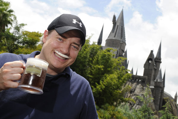 Actor Brendan Fraser experienced The Wizarding World of Harry Potter at Universal Orlando Resort with his family while vacationing in Florida on August 9, 2010. While visiting, Fraser tasted the popular beverage Butterbeer ? a frothy drink, reminiscent of shortbread and butterscotch, served only in Hogsmeade. <span class=meta>(Photo courtesy of Universal Orlando Resort)</span>