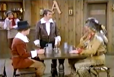 &#39;Happy Days&#39; - &#39;The First Thanksgiving&#39;: Marion is frustrated with her family for watching football games all of Thanksgiving day, so she tells them about the first Thanksgiving.  The episode includes reenactments and Fonzie dressed as a pilgrim with a wooden motorcycle. <span class=meta>(Photo courtesy of ABC)</span>