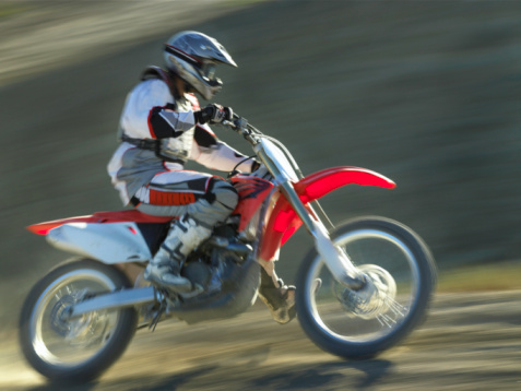 "<div class=""meta ""><span class=""caption-text "">Tom Cruise's adventurous activities seem to be rubbing off on Katie Holmes.  Tom told 'People,' 'I taught her how to ride a dirt bike in an hour and a half; she's a very quick learner.' (Photo courtesy of John Kelly)</span></div>"