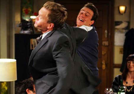 &#39;How I Met Your Mother&#39; - &#39;Slapsgiving&#39;: In season 3, the Slap Bet continues &#40;Marshall wins a bet and gets to slap Barney five times, at any moment of his choosing&#41; on Thanksgiving, moving for Lily to outlaw the Slap Bet on the holiday. <span class=meta>(Photo courtesy of 20th Century Fox Television)</span>