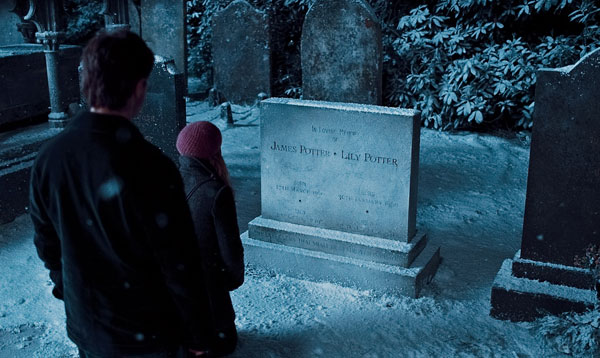 Harry Potter (Daniel Radcliffe) looks at his parents' tombstone in a scene from 'Harry Potter and the Deathly Hallows - Part 1.'