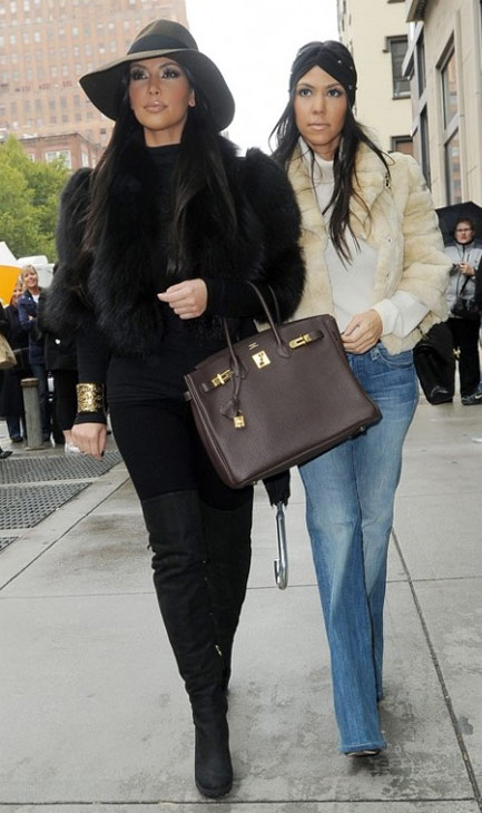"<div class=""meta image-caption""><div class=""origin-logo origin-image ""><span></span></div><span class=""caption-text"">Sunday, Jan. 23, 2011: 'Kourtney and Kim Take New York' - Kim Kardashian and her sister Kourtney appear in this new spin-off of 'Keeping Up With the Kardashians' that debuts on E! at 10 p.m. ET. ( Bunim/Murray Productions/ Ryan Seacrest Productions / Comcast Entertainment Group)</span></div>"