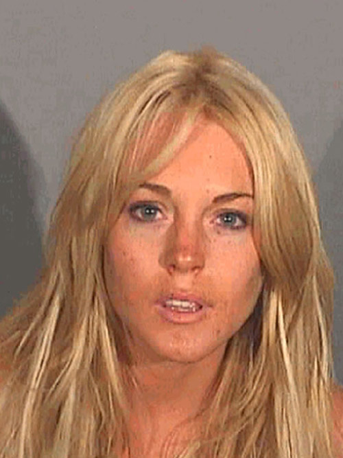 Lindsay Lohan&#39;s mug shot following her July 24, 2007 arrest in Santa Monica, California for drunken driving and cocaine possession. Cops detained her after spotting her SUV chasing another vehicle at high speed. She failed a sobriety test and a search turned up cocaine in her pants pocket. <span class=meta>(Los Angeles Police Department)</span>