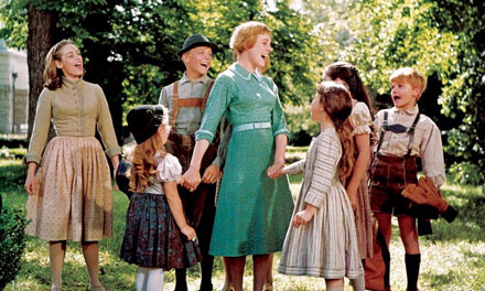 (Pictured from left: Charmian Carr (Liesl), Kym Karath (Gretl), Nicholas Hammond (Friedrich), Julie Andrews (Maria), Debbie Turner (Marta), Angela Cartwright (Brigitta) and Duane Chase (Kurt) in a scene from 'The Sound of Music'.)