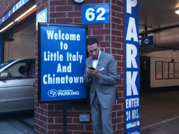 Pee-wee Herman is photographed exiting a parking garage in Chinatown, New York. 'Checking in on @Foursquare in Chinatown and Little Italy! (it takes focus),' the actor Tweeted.