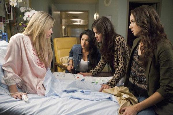 "<div class=""meta ""><span class=""caption-text "">Lucy Hale (Aria), Shay Mitchel (Emily), Troian Bellisario (Spencer) and Ashley Benson (Hanna) appear in the 'Pretty Litle Liars' episode 'Moment Later,' which airs on Jan. 3, 2011 at 8 p.m. ET on ABC Family. (ABC Family / Adam Rose)</span></div>"