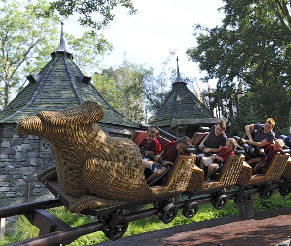 'Harry Potter' film stars Daniel Radcliffe and James Phelps take an inaugural ride on the Flight of the Hippogriff attraction with some of the first guests on June 18.