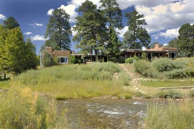 Val Kilmer's New Mexico Ranch. It contains a main log house and a guest house with seven bedrooms and 11 bathrooms in total. The property is as of December 2010 on sale for $18.5 million - down from $33 million in 2009.