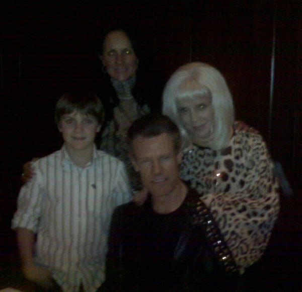 Country music singer Randy Travis and his wife...