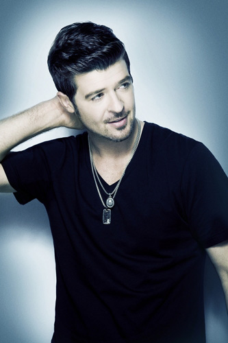 Singer Robin Thicke and his wife, actress Paula...