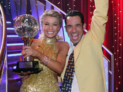"<div class=""meta image-caption""><div class=""origin-logo origin-image ""><span></span></div><span class=""caption-text"">In season 5 of 'Dancing with the Stars,' Helio Castroneves and Julianne Hough were announced as the first place winners in the fall of 2007.  Castroneves is a famous racecar driver and is known for his signature victory celebration of climbing the fence after taking the checkered flag. (Photo courtesy of ABC)</span></div>"